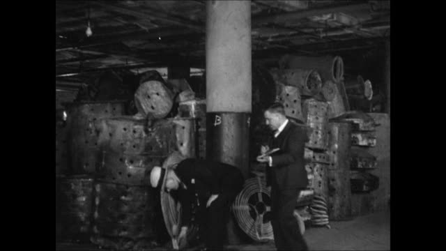 in office looking at photo of building raiding same building arresting bootleggers chopping holes in basement still - 1937 stock videos and b-roll footage