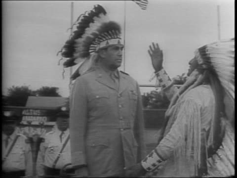 in oklahoma us air force brigadier general arthur w vanaman becomes an indian chief in ceremony / a native american places a war bonnet headdress on... - headdress stock videos and b-roll footage