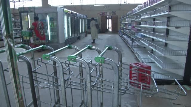stockvideo's en b-roll-footage met in one of the biggest supermarkets in harare zimbabwe's capital cooking oil rice and coca cola are all out of stock while a notice on the bread rack... - financieel item