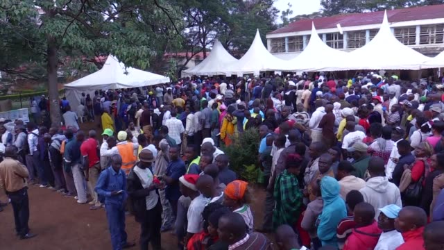 in opposition candidate raila odinga's stronghold of kisumu in western kenya some voters say they have stayed up all night to ensure their place in... - raila odinga stock videos and b-roll footage