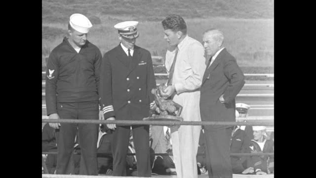 in outdoor boxing ring sot gene tunney presents heavy trophy depicting two wrestlers to commander abbott of the uss chester on behalf of the winner... - sailor stock videos & royalty-free footage