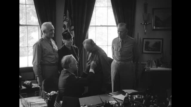 in oval office of white house, roosevelt pins medal on brig. gen. jimmy doolittle, standing behind roosevelt from left to right general henry arnold,... - medal stock videos & royalty-free footage