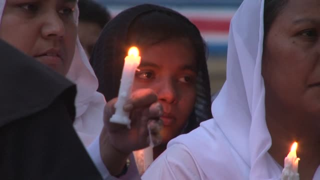 in pakistan anguished families spent easter monday burying their dead after a taliban suicide bomber targeting christians over easter killed 72... - lahore stock videos and b-roll footage