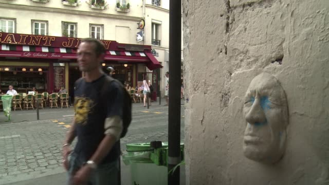 in paris the walls have ears and a nose and a mouth. voiced : frances man in the papier mache mask on september 07, 2013 in paris, france - papier stock videos & royalty-free footage