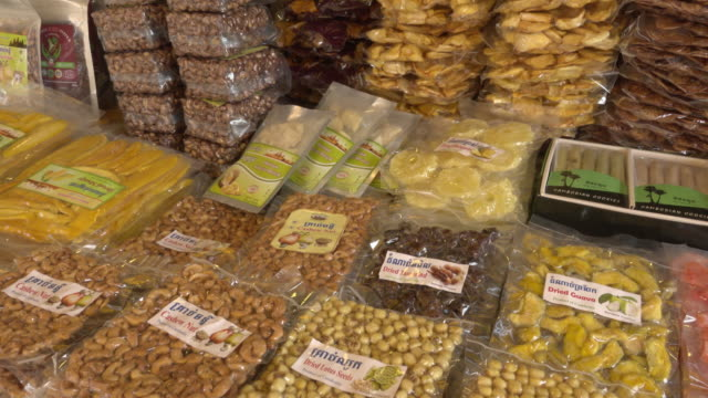 pan / in plastic packaged food at street market in siem reap town - nut food stock videos & royalty-free footage