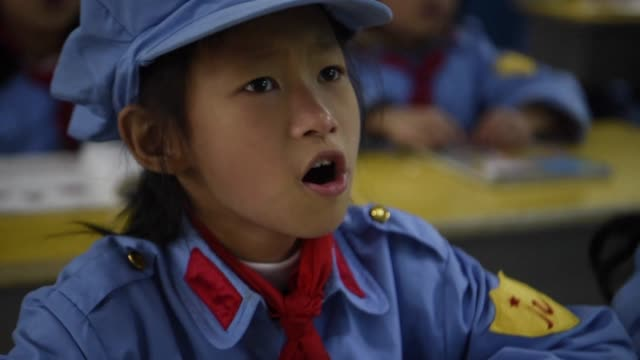 In powder blue and gray military uniforms red kerchiefs and caps emblazoned with crimson stars young Chinese students in the southwestern province of...