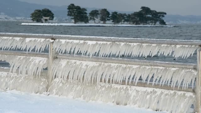 in proof that mother nature is the greatest artist, look no further than lake shinjiko where the cold snap has created a stunning display of... - shimane prefecture stock videos & royalty-free footage