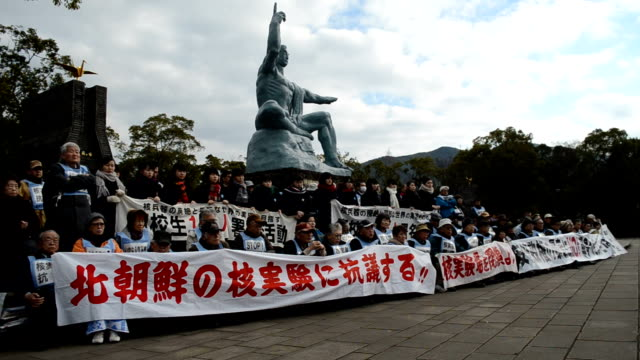in protest against north korea's fresh nuclear test about 100 citizens comprising students and survivors of us atomic bombing on nagasaki in western... - massenvernichtungswaffe stock-videos und b-roll-filmmaterial