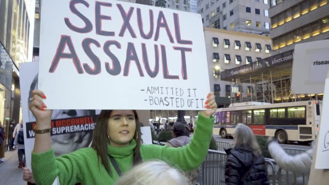in protest of president donald trump's state of the union speech on february 5 antitrump activist rallied in front of the 5th avenue trump tower in... - sexual violence stock videos & royalty-free footage