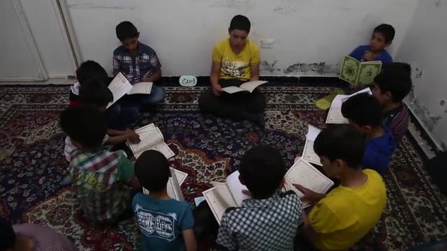 In rebel held Douma a besieged town near Syria's capital an NGO stages daily Ramadan educational activities and prayers for orphaned children all...