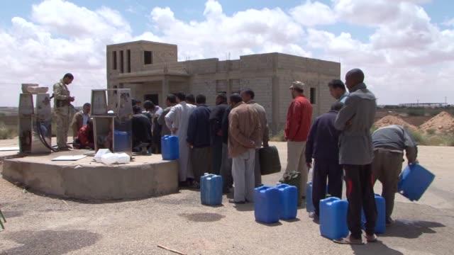 in rebel-held western libya, local are struggling with shortages of food, water and fuel. jadu, libya. - arab spring stock videos & royalty-free footage