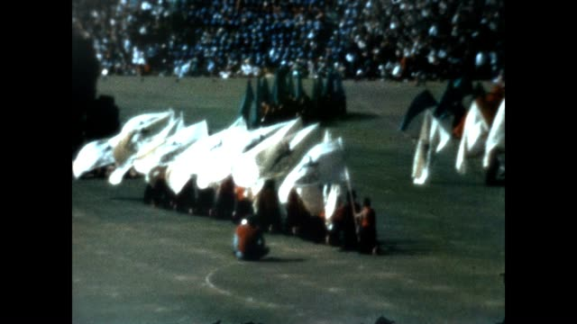 vídeos de stock e filmes b-roll de in response to the exclusion of apartheid south africa from the 1964 olympics the south african open games commenced these home movies show the... - 1964