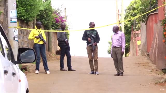 In Ruaka north west of Nairobi Kenyan police stand guard outside the house of one of the terrorists that targeted a luxury hotel complex in Nairobi