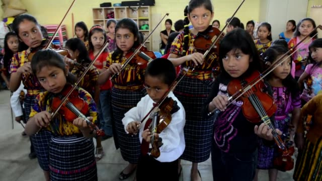 in san juan sacatepequez guatemala there an unusual symphony orchestra the players are indigenous maya children clean indigenous children in... - latin american civilizations stock videos and b-roll footage