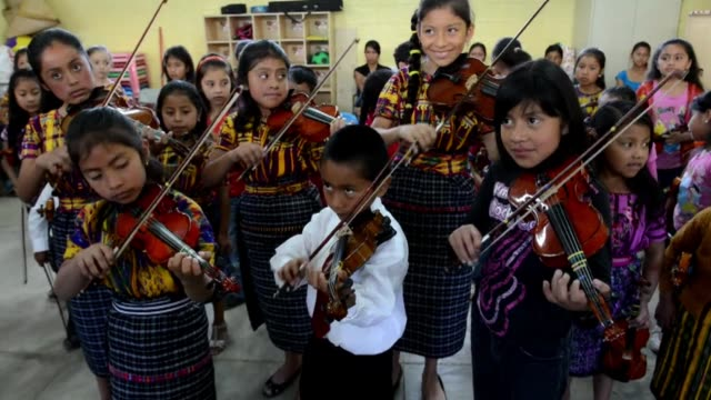 in san juan sacatepequez guatemala theres an unusual symphony orchestra the players are indigenous maya children clean indigenous children in... - latin american civilizations stock videos and b-roll footage