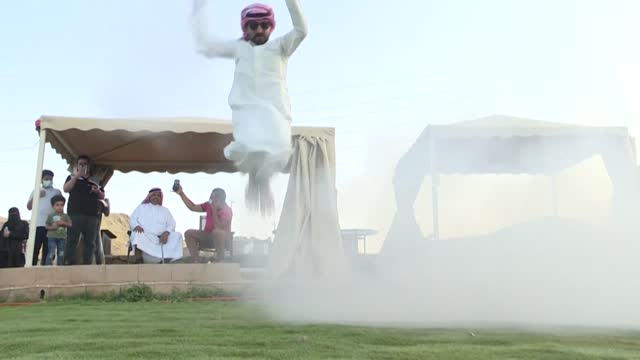 """in saudi arabia's west, classic muzzle-loading rifles are carefully prepared for the traditional """"taasheer"""" war dance, a striking display of leaping... - gunpowder explosive material stock videos & royalty-free footage"""