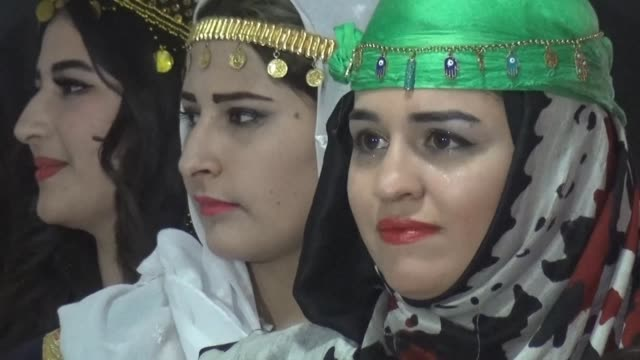 vídeos y material grabado en eventos de stock de in shimmering dresses models stride confidently down a runway to the beat of kurdish music at a fashion show in northeast syria showcasing a revival... - paso largo