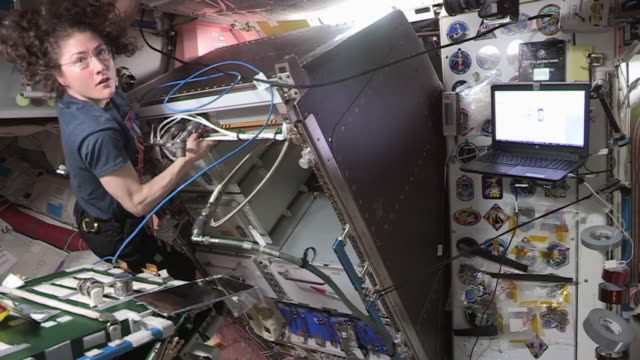 in space-february 6, 2020: clean, color corrected, and broadcast-safe clip of astronaut christina koch in the international space station during... - atmosphere filter stock videos & royalty-free footage