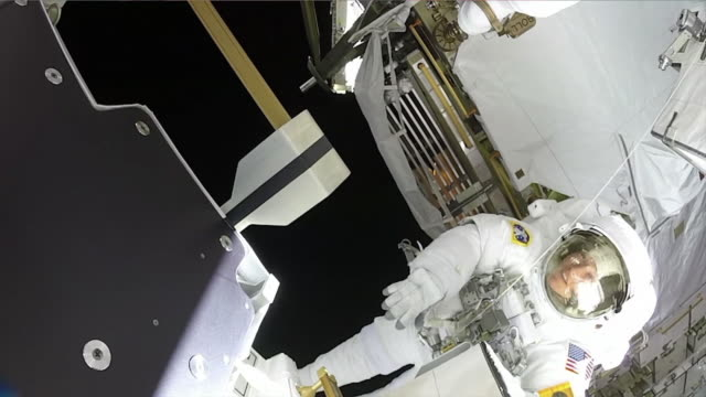 in space-february 6, 2020: spacewalk on the iss. clean, color corrected, and broadcast-safe clip of astronaut christina koch in the international... - atmosphere filter stock videos & royalty-free footage
