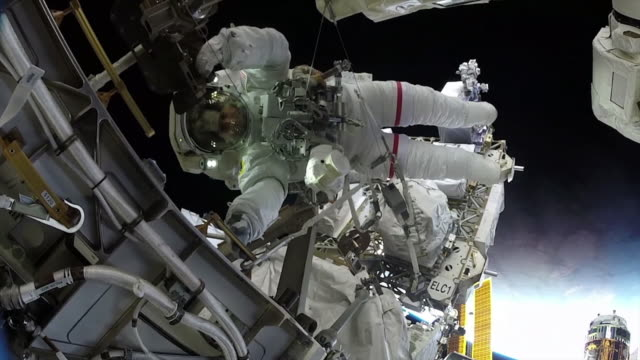 in space-february 6, 2020: spacewalk on the iss. clean, color corrected, and broadcast-safe clip of astronaut christina koch in the international... - spacewalk stock videos & royalty-free footage