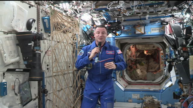 astraunaut and medicine doctor andrew morgan aboard the iss responds to questions from diverse people at the brooke army medical center this clip is... - one person stock videos & royalty-free footage