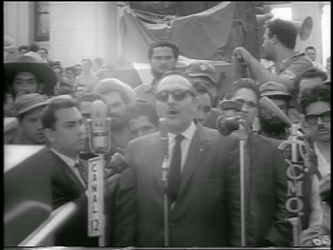 in sunglasses making speech outdoors / postrevolution havana - 1959 stock videos and b-roll footage