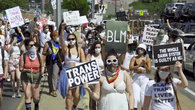 vídeos de stock, filmes e b-roll de in support of equal rights for the black transgender community thousands rally at the brooklyn museum in light of gay pride month and the recent... - made in the usa frase americana