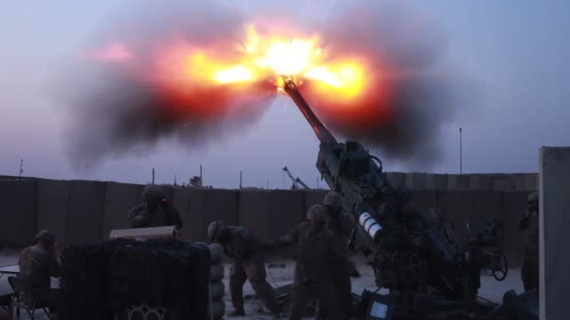 in support of the iraqi security forces us army field artillery soldiers fire a m777 towed 155 mm howitzer to disrupt known enemy positions from... - battalion stock videos & royalty-free footage