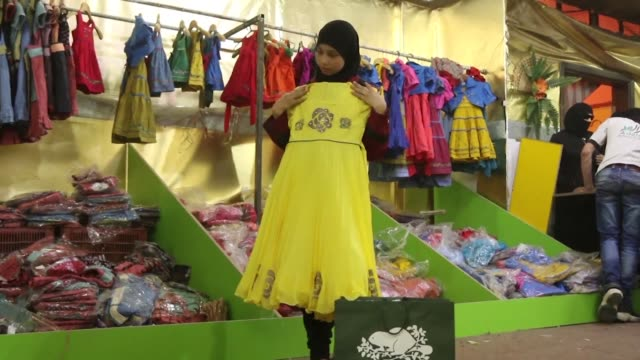 in syria's besieged rebelheld town of douma in the eastern ghouta region outside damascus the adaleh foundation organises distributions of brand new... - eid mubarak stock videos & royalty-free footage