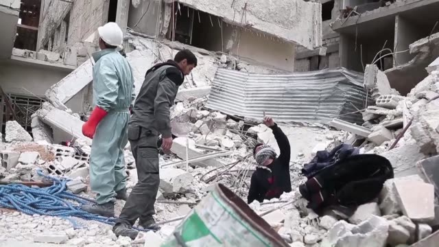 in syria's rebel held eastern ghouta enclave the bombs have stopped falling from the sky but the dead are still being raised from the rubble - rubble stock videos & royalty-free footage