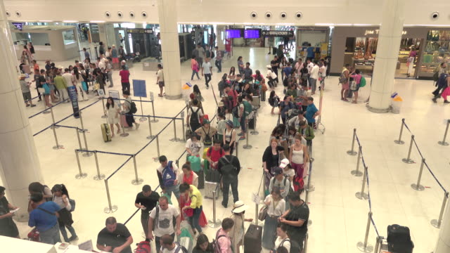 in terminal airport - waiting in line stock videos & royalty-free footage