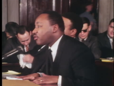in testimony at a us senate hearing, the reverend martin luther king, jr. speaks of the economic problems caused by inequality. - アメリカ公民権運動点の映像素材/bロール