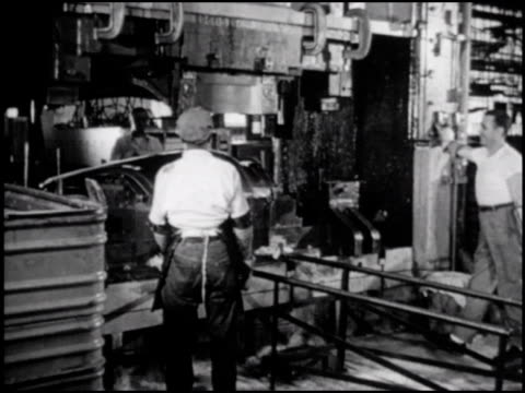 / in the 4th of 5 segments body stamping machines are used to stamp body parts out of sheets of steel / the parts are then assembled on jigs and spot... - 1952 stock videos & royalty-free footage