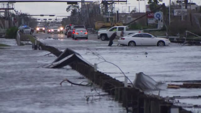 in the aftermath of hurricane michael a man pushes a car through a heavily flooded street in panama city beach florida on october 10 2018 - environment or natural disaster or climate change or earthquake or hurricane or extreme weather or oil spill or volcano or tornado or flooding stock videos & royalty-free footage