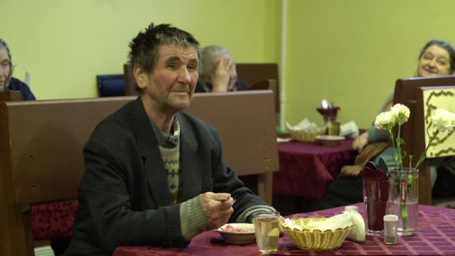 in the basement of a central apartment bloc in saint petersburg a cafe offers free food for the elderly a group particularly hard hit by the economic... - basement stock videos and b-roll footage