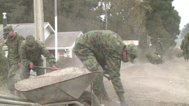 In the Chilean town of Ensenada the military is hard at work cleaning up the ash and debris from the eruption of the Calbuco volcano
