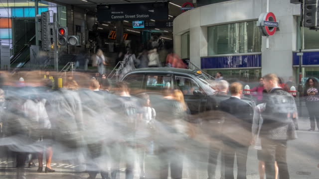 in the city of london a constant flow of commuters move rapidly into one of cannon street train stations entrances during the evening rush hour - blurred motion stock videos & royalty-free footage
