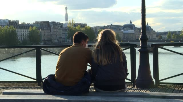 in the city of love, masks and curfews have put a damper on romance, as dating and flirting gives way to a fear of contamination - flirting stock videos & royalty-free footage