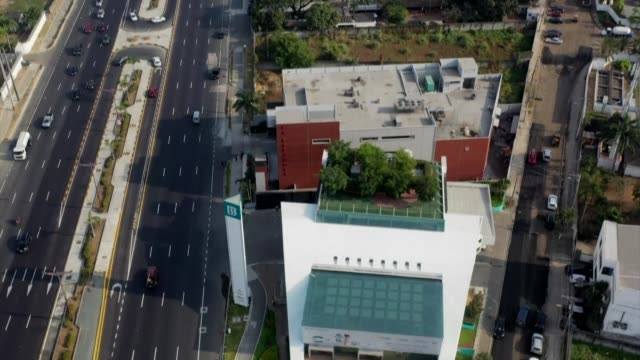 stockvideo's en b-roll-footage met in the coastal city of guayaquil in southwestern ecuador two young environmental engineers fight against climate change by creating green walls green... - coastal feature