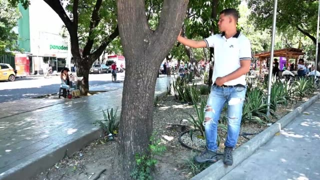 in the colombian border town of cucuta venezuelan migrants feel sad for the internal division over the country's leadership but at the same time have... - maduro stock videos & royalty-free footage