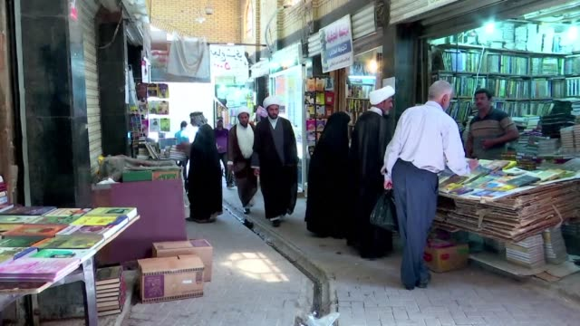 in the covered alleyways of old najaf in iraq poetry and philosophy books compete on laden shelves with economic treatises the koran and other... - najaf stock videos & royalty-free footage