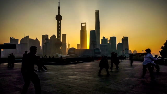 in the early morning,people practise kongfu at the bund, shanghai, china - river huangpu stock videos & royalty-free footage