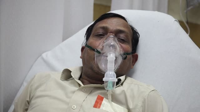 In the emergency ward of a Delhi hospital men and women gasp for breath as they wait to be treated for symptoms triggered by the choking blanket of...