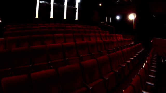 stockvideo's en b-roll-footage met in the empty cinema hall - theater