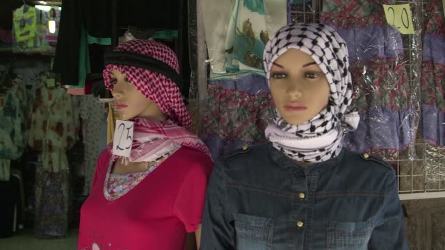 in the face of strong competition from china the traditional locally produced palestinian headscarf has put up a show of resistance successfully... - headscarf stock videos & royalty-free footage