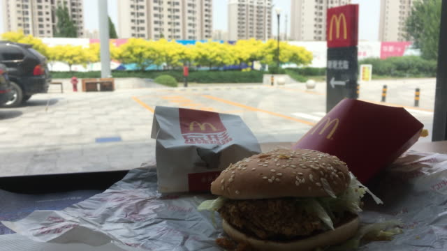 in the first quarter of 2018 mcdonald's profit increased 14% to $138 billion us dollar exceeding market expectations especially benefited from strong... - mcdonald's stock videos and b-roll footage