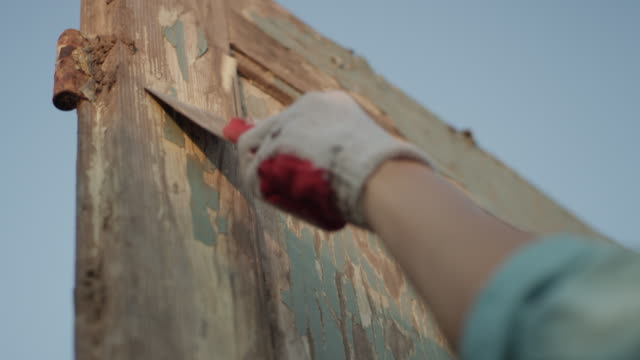 diy in the garden. renovating old wooden doors - diy stock videos and b-roll footage
