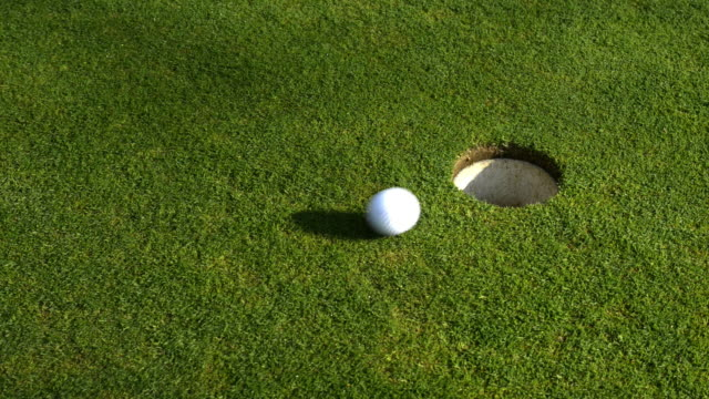 in the hole! - golf ball stock videos & royalty-free footage