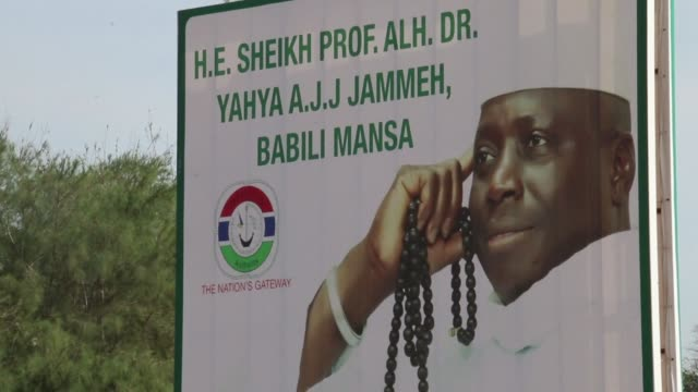 in the home village of former gambian leader yahya jammeh billboards bearing his image are still in place following his decision to leave the country... - decisions stock videos & royalty-free footage