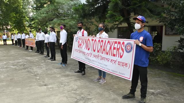 in the interest of observing deepawali as pollution-free, the nss unit and the students' union of nowgong college arranged a human chain programme to... - human interest stock videos & royalty-free footage